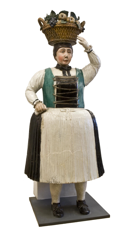 """Kachelofen, sog. Figurenofen, bekannt als """"Ofenbäuerin"""" oder """"Annamirl"""" von Pollack, Ernst"""